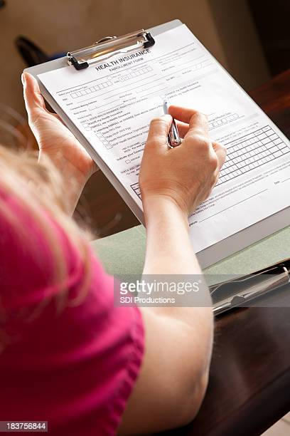 Nurse Pointing On Medical Health Insurance Form