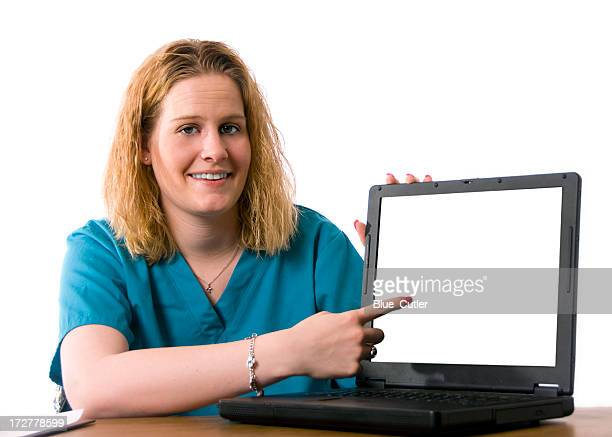 nurse pointing - nurse and portrait and white background and smiling and female and looking at camera stock pictures, royalty-free photos & images