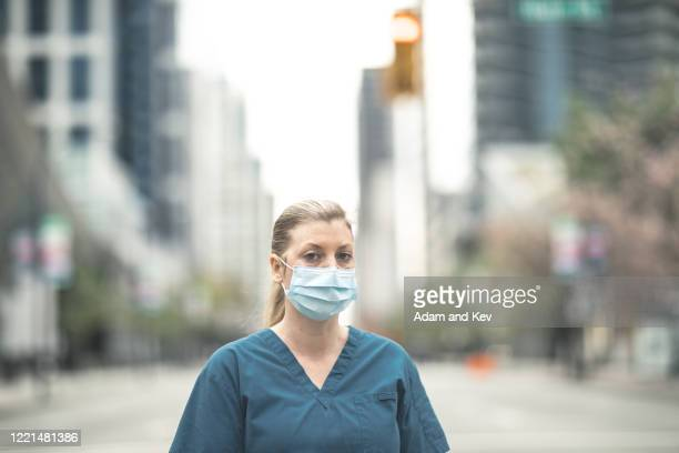 nurse portrait in the city - leanincollection stock pictures, royalty-free photos & images