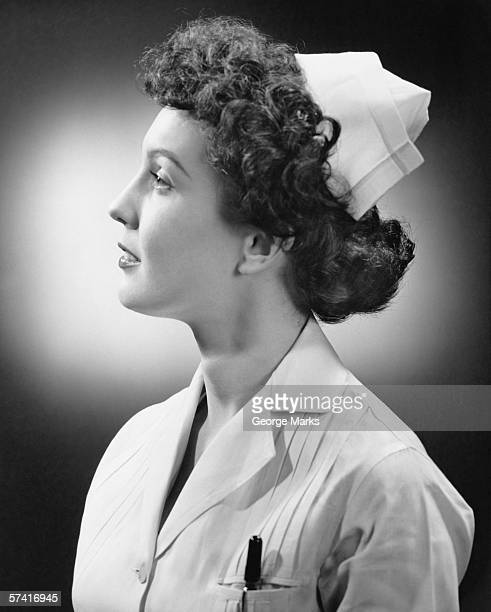 nurse posing in studio, (b&w), (close-up), (portrait) - 20th century stock photos and pictures