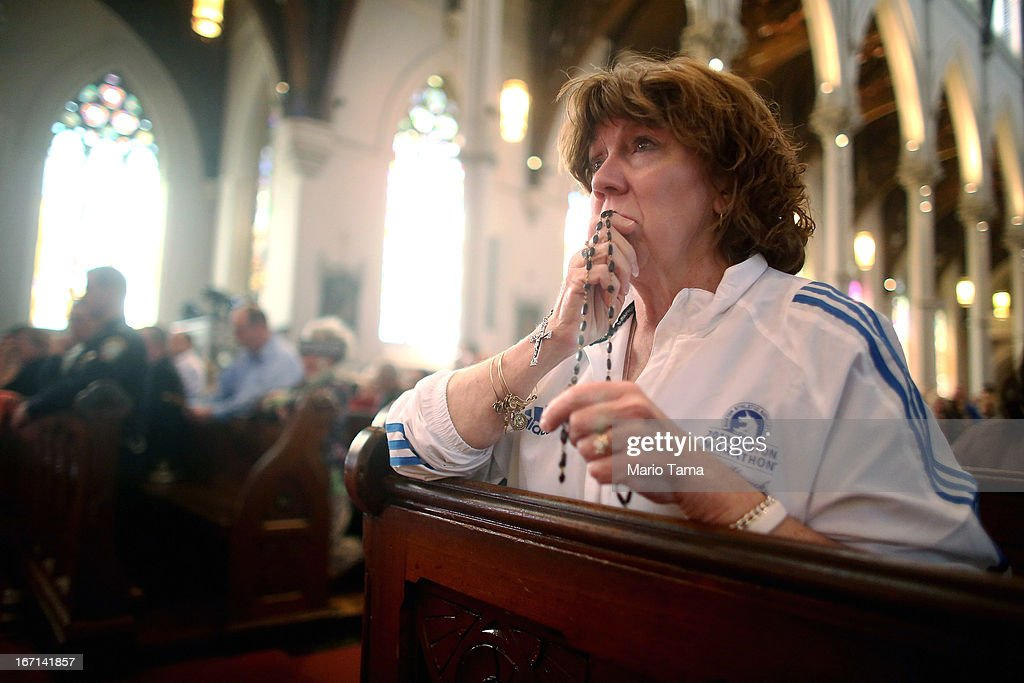 Nurse practitioner Maureen Quaranto (R), who treated victims of the Boston Marathon bombings in Tent A, wears her Boston Marathon jacket during Mass at the Cathedral of the Holy Cross on the first Sunday after the Boston Marathon bombings on April 21, 2013 in Boston, Massachusetts. Quaranto said she will definitely attend the marathon next year and added, 'There is evil but there is a lot more good, a lot more love.' The Mass honored the victims of the bombings and subsequent manhunt as well as first responders.