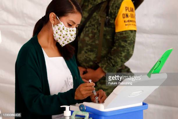 Nurse prepares a Pfizer BioNTech dose, before vaccinate a person during mass vaccination campaign for people of 40 to 49 years old to immunize...