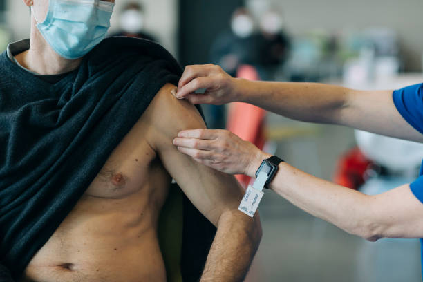 A nurse prepares to give a Covid-19 vaccine at a mass vaccination site in The Dalles, Oregon on March 29, 2021.