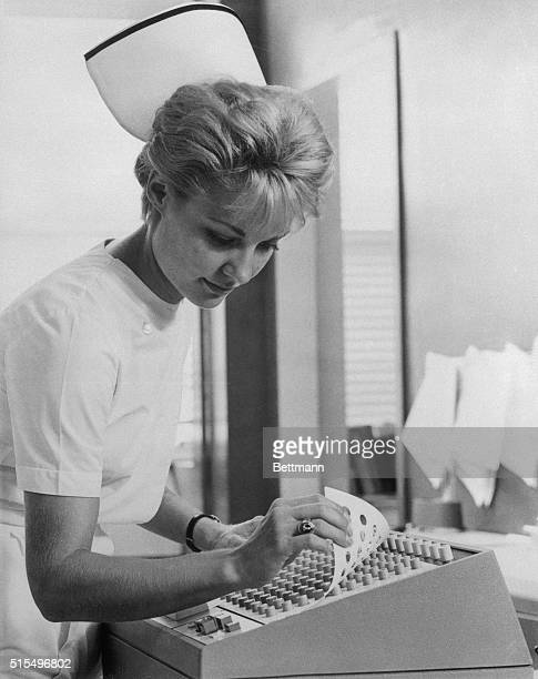 A nurse prepares to order drugs from a hospital pharmacy in a new way by computer The typewriter sized terminal on her floor is linked to an...