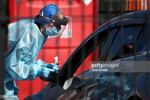 A nurse prepares to test people at a Covid19 testing facility in Eden Terrace on August 13 2020 in Auckland New Zealand COVID19 restrictions have...