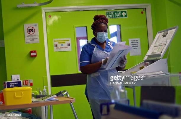 Nurse Princess Kavanire wearing a protective face mask, works on Ward D1 at the Royal Blackburn Teaching Hospital in Blackburn, north-west England on...