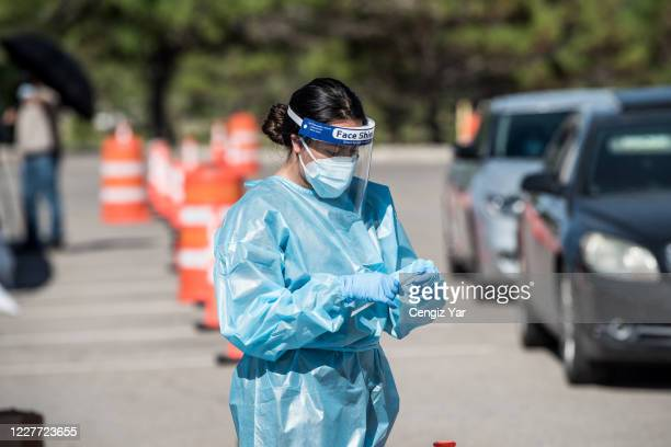 Nurse pulls out a testing swab at a newly opened mega drive-thru site at El Paso Community College Valle Verde campus on July 21, 2020 in El Paso,...