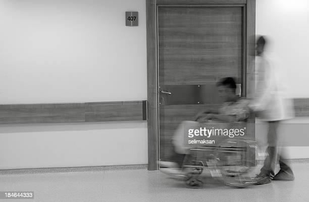Nurse Pushing patient Sitting in Wheelchair, Blurred Motion