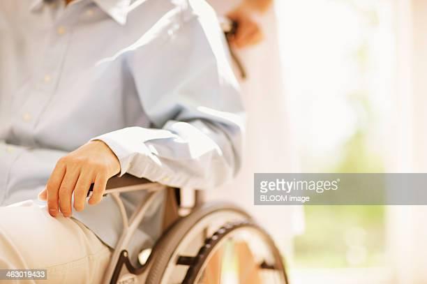 Nurse Pushing Wheelchair
