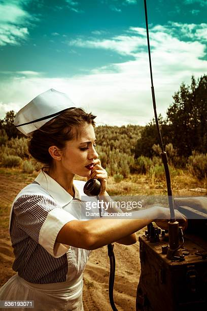 wwii nurse radios for help on a battlefield telephone - hot nurse stock photos and pictures