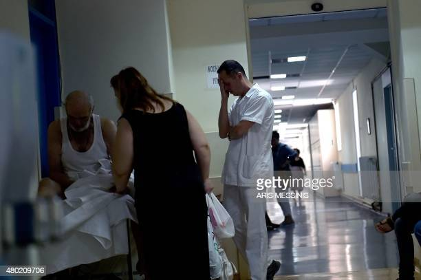 A nurse reacts as he stands in an Athens hospital on July 8 2015 With expectations of a Greek exit from the eurozone gathering pace health officials...