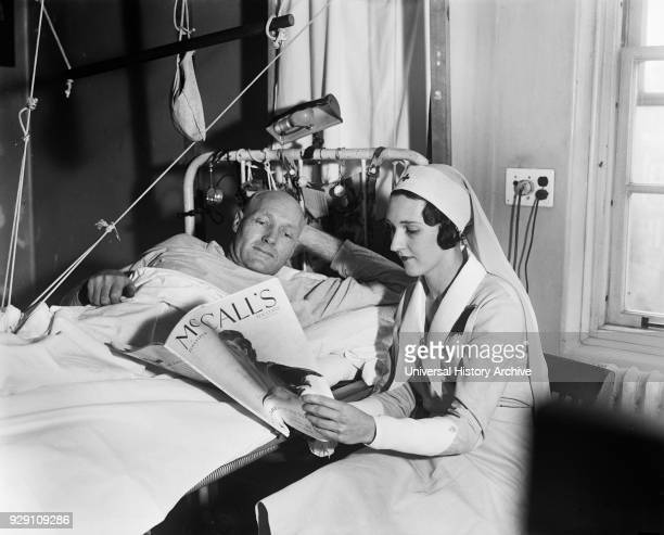 Nurse Reading to Male Patient in Hospital Harris Ewing 1933