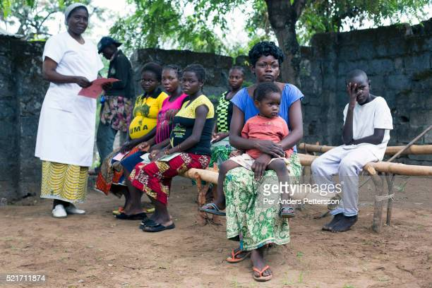 Nurse registers mothers before children being vaccinated in a clinic in a village outside Kinshasa, Democratic Republic of Congo. Kinshasa has a...