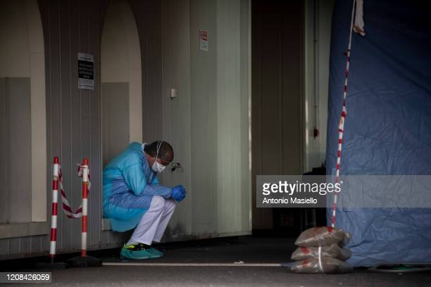 Nurse rests during the Coronavirus emergency at the fourth Covid hospital in the Tor Vergata unit, on March 27 in Rome, Italy. Hospitals in Italy are...