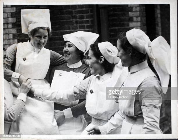 Nurse Ruby Rosser being congratulated by some of the other nurses at the Grove Park Hospital in London England after the announcement that she is to...