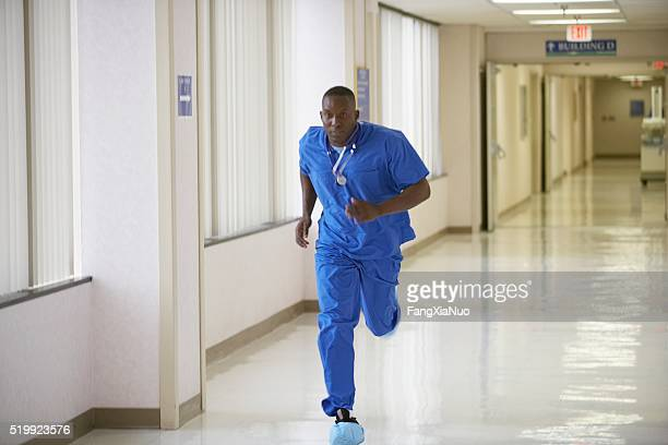 Nurse running through a hospital corridor