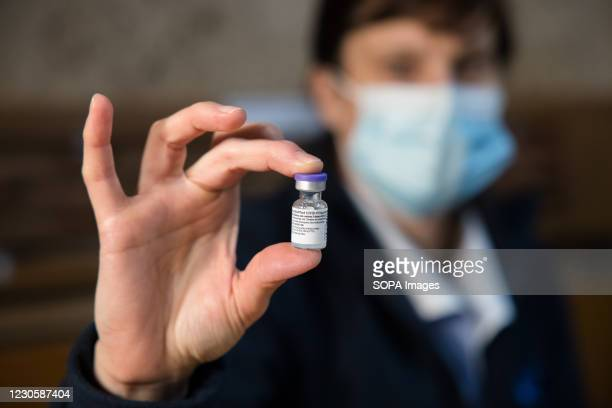 Nurse shows a vial of Pfizer-BioNtech COVID-19 vaccine. Voluntary mass COVID-19 vaccination of people over the age of 80 is under way in Slovenia.