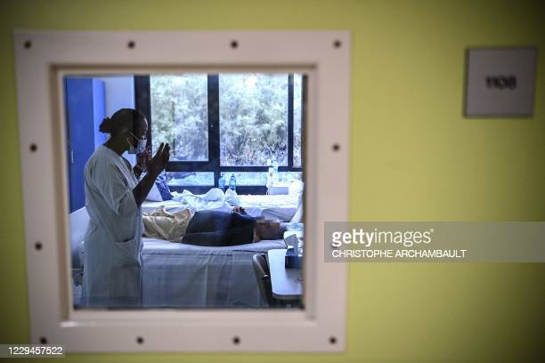Nurse speaks with a patient with mental disorders in her room at The Ville-Evrard Psychiatric Hospital in Saint-Denis, north of Paris on November 3,...