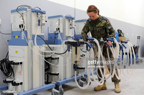 Nurse Staff Sargeant Antje S from the rapid deployment medical services troups prepares an anaesthesia machine for shipment to Mali in Leer Germany...