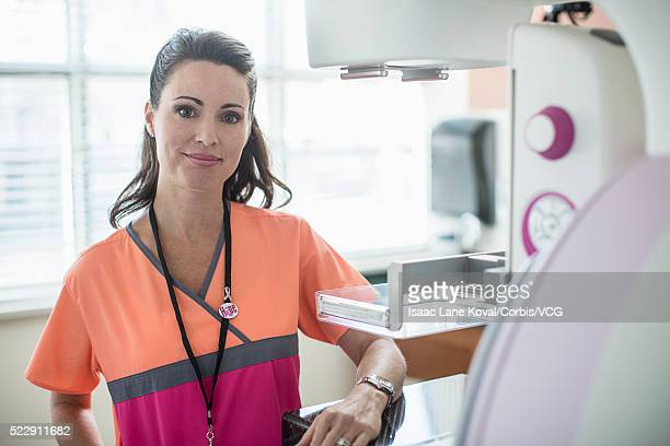 Nurse standing next to mammogram machine