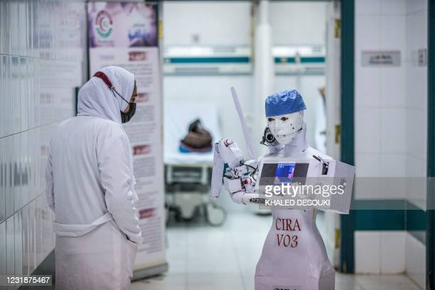 Nurse stands by the CIRA-03 robot prototype built as part of a self-funded project to assist physicians in running tests on suspected COVID-19...
