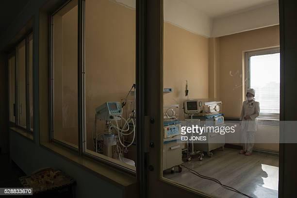 A nurse stands in a ward at the Pyongyang Maternity Hospital during a governmentorganised media tour in Pyongyang on May 7 2016 North Korea organised...