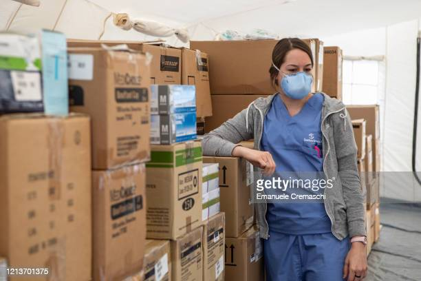 A nurse stands inside a tent with stocked medical supplies at a Samaritan's Purse Emergency Field Hospital on March 20 2020 in Cremona near Milan...
