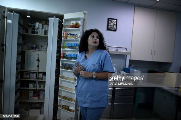 A nurse stands next to a medicine locker in an Athens hospital on July 7 2015 With expectations of a Greek exit from the eurozone gathering pace...