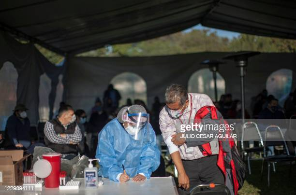 Nurse takes a blood sample from a person to perform a COVID-19 serological test in Escobedo, state of Nuevo Leon, Mexico on December 01, 2020. - The...