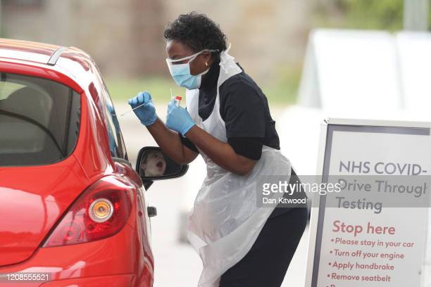 Nurse takes a swab at a Covid-19 Drive-Through testing station for NHS staff on March 30, 2020 in Chessington, United Kingdom. The Coronavirus...