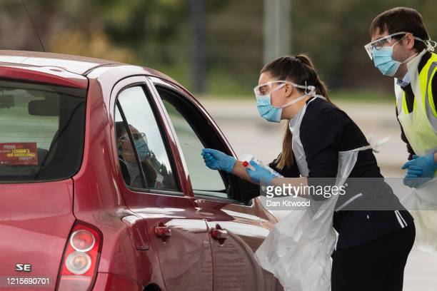 A nurse takes a swab at a Covid19 drivethrough testing station for NHS staff on March 30 2020 in Chessington United Kingdom The Coronavirus pandemic...