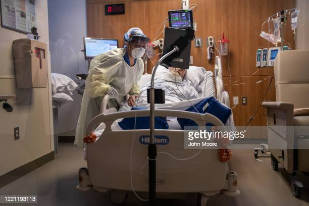 Nurse takes part in a Zoom video call with a COVID-19 in a Stamford Hospital intensive care unit , on April 24, 2020 in Stamford, Connecticut....