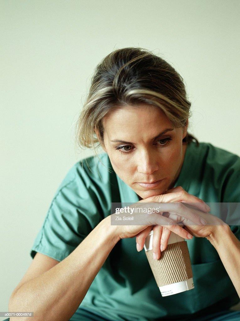 Nurse Taking Coffee Break : Stock Photo