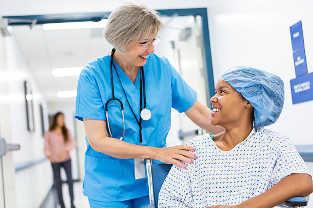 nurse taking patient to recovery after outpatient surgical procedure - preparation stock pictures, royalty-free photos & images