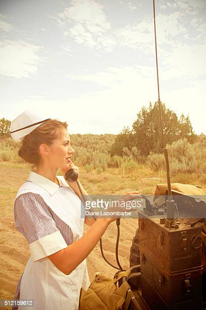WWII Nurse Talking On The Telephone In The Desert