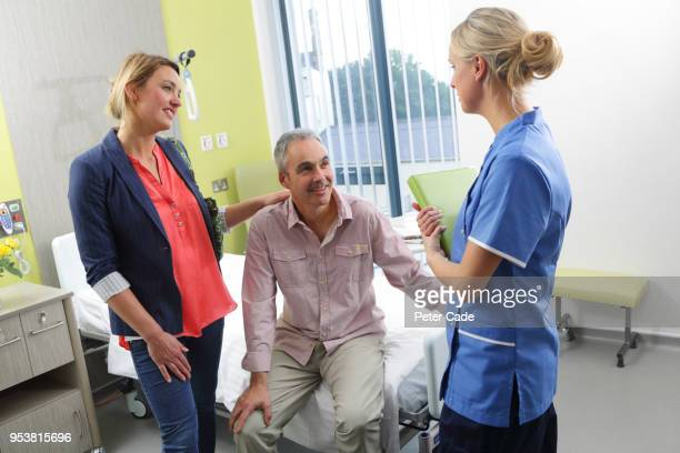 Nurse talking to couple