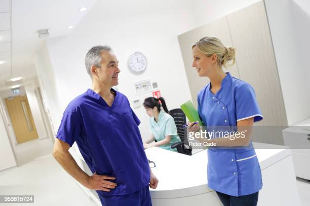 Nurse talking to doctor