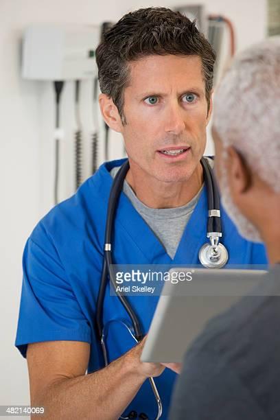 Nurse talking to patient in doctor's office
