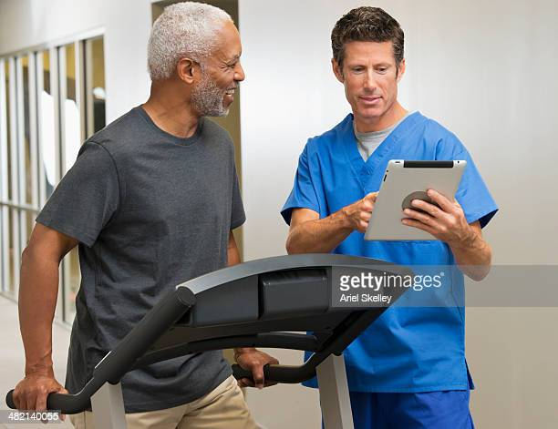 Nurse talking to patient in physical therapy
