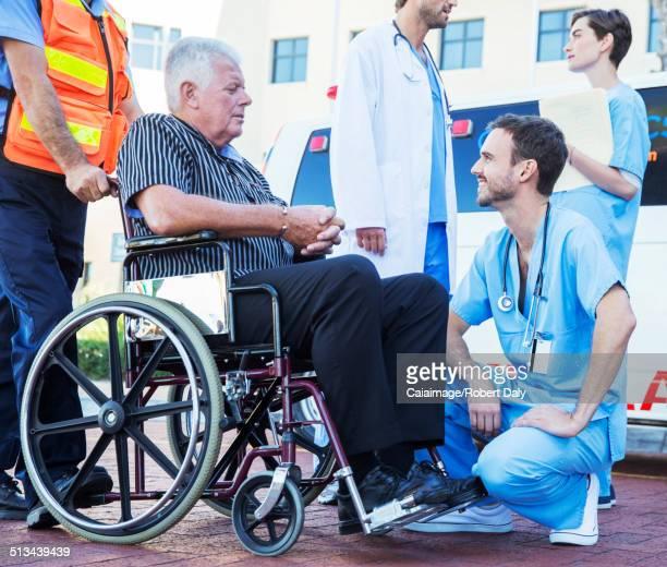 Nurse talking to patient outside ambulance