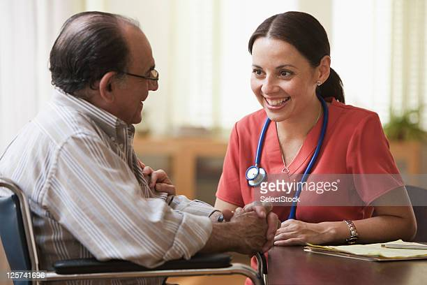 Nurse Talking with an elderly man