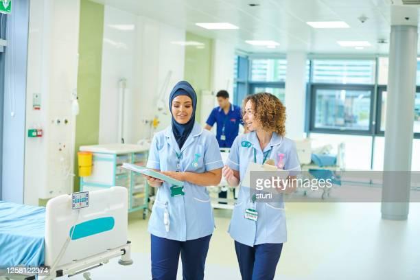 nurse team - patient stock pictures, royalty-free photos & images