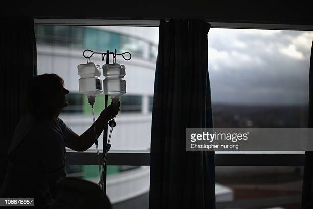A nurse tends to a patient in the recently opened Birmingham Queen Elizabeth Hospital on February 7 2011 in Birmingham England The new Queen...