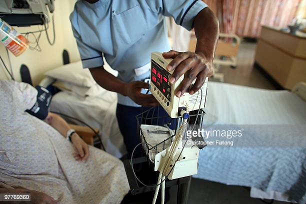 A nurse tends to recovering patients on a general ward at The Queen Elizabeth Hospital on March 16 2010 in Birmingham England As the UK gears up for...