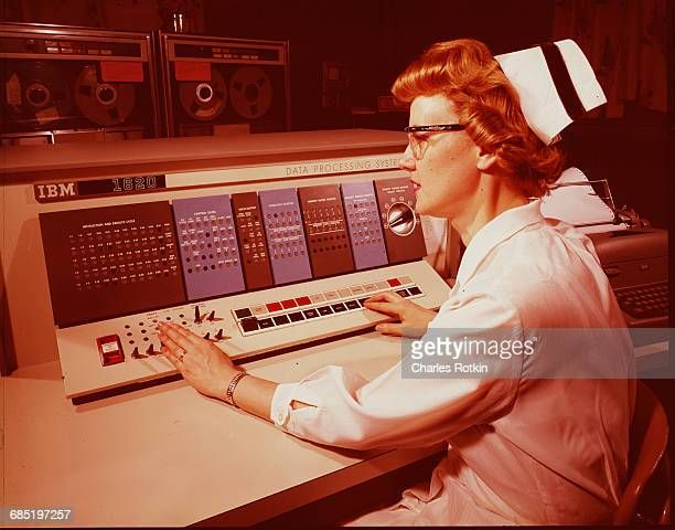 A nurse tests a data processing system the IBM 1620 at an experimental nurse's station in Akron Ohio The computer is being tested for use at the...