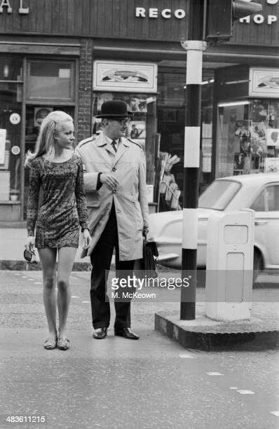 Nurse turned model Stevie Norbury wearing a brown printed silk minidress London 1968