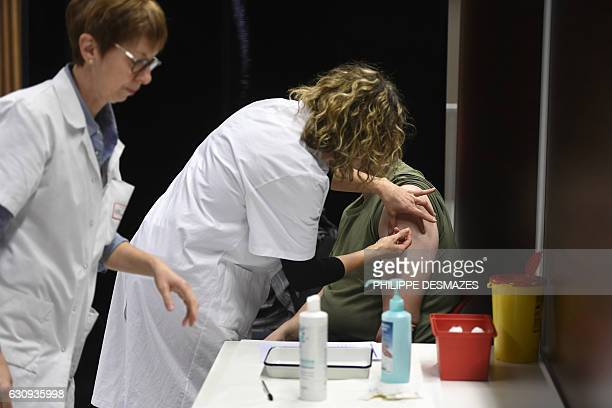 A nurse vaccinates a student against meningitis on January 4 2017 at the University of Dijon Thirty thousand people are invited to be vaccinated...