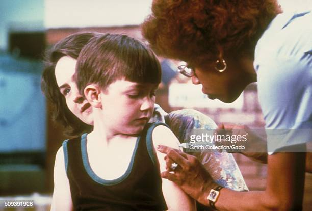 Nurse vaccinating child Image courtesy CDC 1974