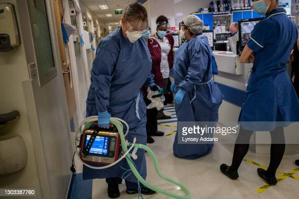 Nurse Vernett Worrell 45, transporting non-invasive ventilation for the suspected COVID-19 patient on May 25, 2020 in Coventry, United Kingdom. Like...