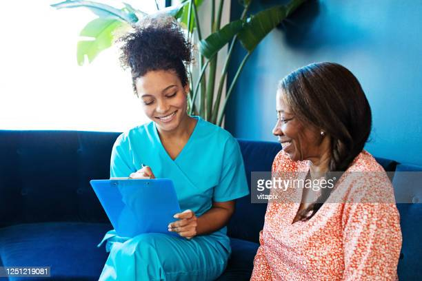 nurse visiting a senior patient - ontario canada stock pictures, royalty-free photos & images